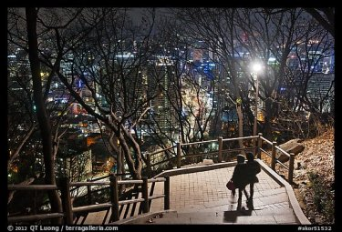 Couple walking down Namsan stairs by night. Seoul, South Korea